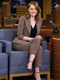 celebrity wearing brown suit