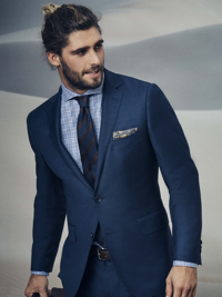 man in blue suit and tie